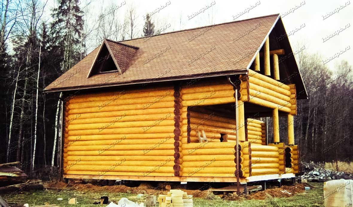 Покраска-сруба-дома-в-Островках
